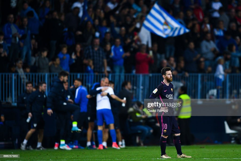 Lionel Messi of FC Barcelona looks on dejected after Jony Rodriguez of Malaga CF scored his team's second goal during the La Liga match between Malaga CF and FC Barcelona at La Rosaleda stadium on April 8, 2017 in Malaga, Spain.