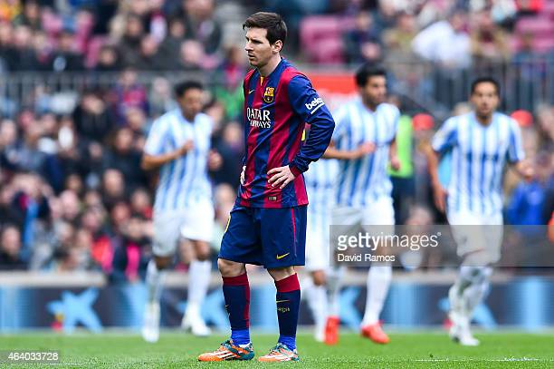Lionel Messi of FC Barcelona looks on dejected after Juanmi Jimenez of Malaga CF scored the opening goal during the La Liga match between FC...