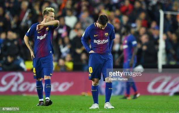 Lionel Messi of FC Barcelona looks on dejected after Rodrigo Moreno of Valencia CF scored his team's first goal during the La Liga match between...