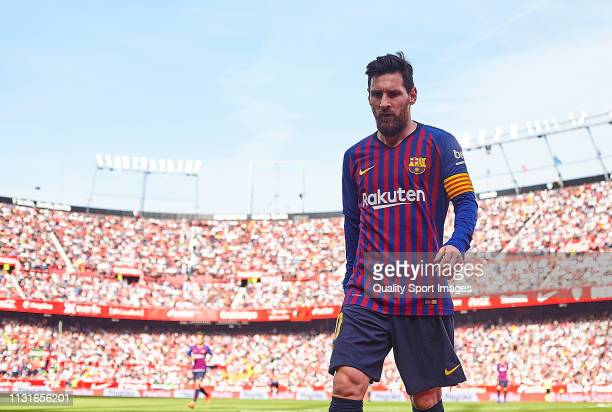 Lionel Messi of FC Barcelona looks on during the La Liga match between Sevilla FC and FC Barcelona at Estadio Ramon Sanchez Pizjuan on February 23,...