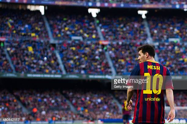 Lionel Messi of FC Barcelona looks on during the La Liga match between FC Barcelona and CA Osasuna at Camp Nou on March 16 2014 in Barcelona Spain