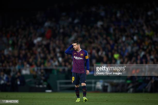 Lionel Messi of FC Barcelona looks on during the La Liga match between Real Betis Balompie and FC Barcelona at Estadio Benito Villamarin on March 17...