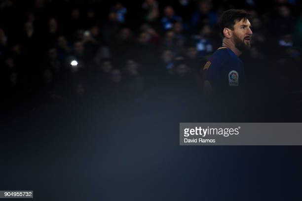 Lionel Messi of FC Barcelona looks on during the La Liga match between Real Sociedad and FC Barcelona at Anoeta stadium on January 14 2018 in San...