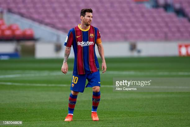 Lionel Messi of FC Barcelona looks on during the La Liga Santander match between FC Barcelona and Real Madrid at Camp Nou on October 24, 2020 in...