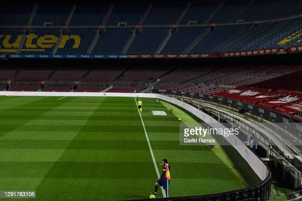 Lionel Messi of FC Barcelona looks on during the La Liga Santander match between FC Barcelona and Real Sociedad at Camp Nou on December 16, 2020 in...