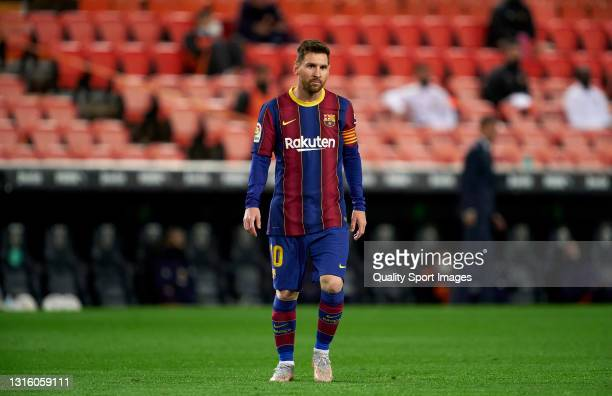 Lionel Messi of FC Barcelona looks on during the La Liga Santander match between Valencia CF and FC Barcelona at Estadio Mestalla on May 02, 2021 in...