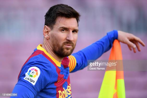 Lionel Messi of FC Barcelona looks on during the La Liga Santander match between FC Barcelona and Atletico de Madrid at Camp Nou on May 08, 2021 in...