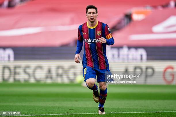 Lionel Messi of FC Barcelona looks on during the La Liga Santander match between FC Barcelona and RC Celta at Camp Nou on May 16, 2021 in Barcelona,...