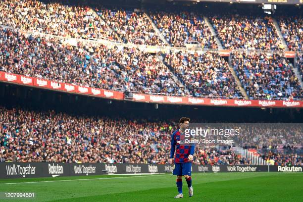 Lionel Messi of FC Barcelona looks on during the Liga match between FC Barcelona and SD Eibar SAD at Camp Nou on February 22, 2020 in Barcelona,...