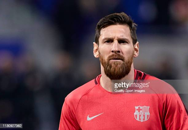 Lionel Messi of FC Barcelona looks on during the prematch warm up before the UEFA Champions League Round of 16 First Leg match between Olympique...