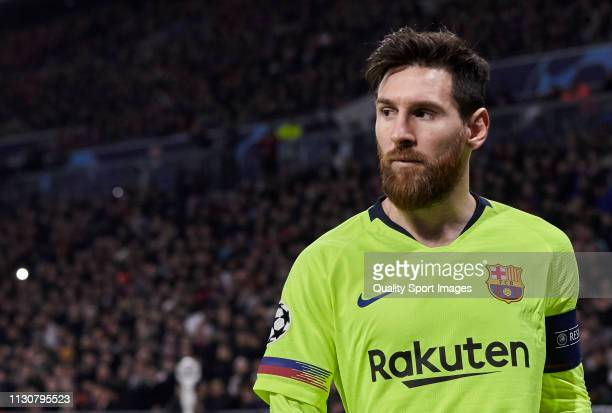 Lionel Messi of FC Barcelona looks on during the UEFA Champions League Round of 16 First Leg match between Olympique Lyonnais and FC Barcelona at...