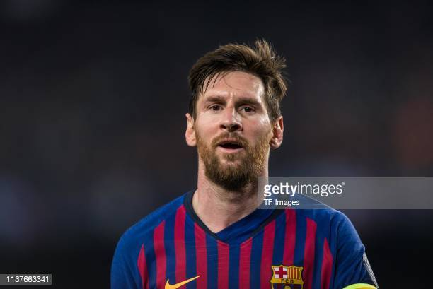 Lionel Messi of FC Barcelona looks on during the UEFA Champions League Quarter Final second leg match between FC Barcelona and Manchester United at...