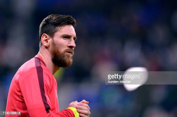 Lionel Messi of FC Barcelona looks on during warmup before the UEFA Champions League Round of 16 First Leg match between Olympique Lyonnais and FC...