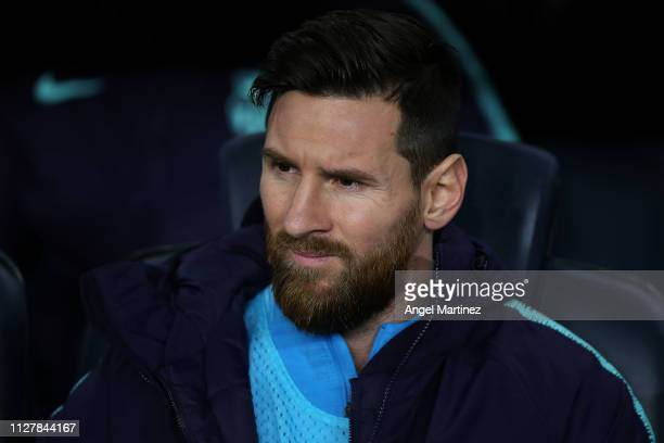 Lionel Messi of FC Barcelona looks on from the bench during the Copa del Semi Final first leg match between Barcelona and Real Madrid at Nou Camp on...