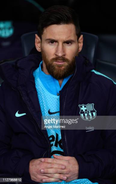 Lionel Messi of FC Barcelona looks on from the bench during the Copa del Rey Semi Final match between FC Barcelona and Real Madrid at Nou Camp on...