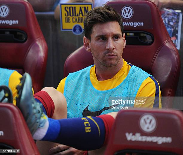 Lionel Messi of FC Barcelona looks on from the substitutes bench during the La Liga match between Club Atletico de Madrid and FC Barcelona at Vicente...