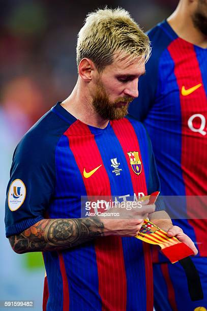 Lionel Messi of FC Barcelona looks the captain armband after the Spanish Super Cup Final second leg match between FC Barcelona and Sevilla FC at Camp...