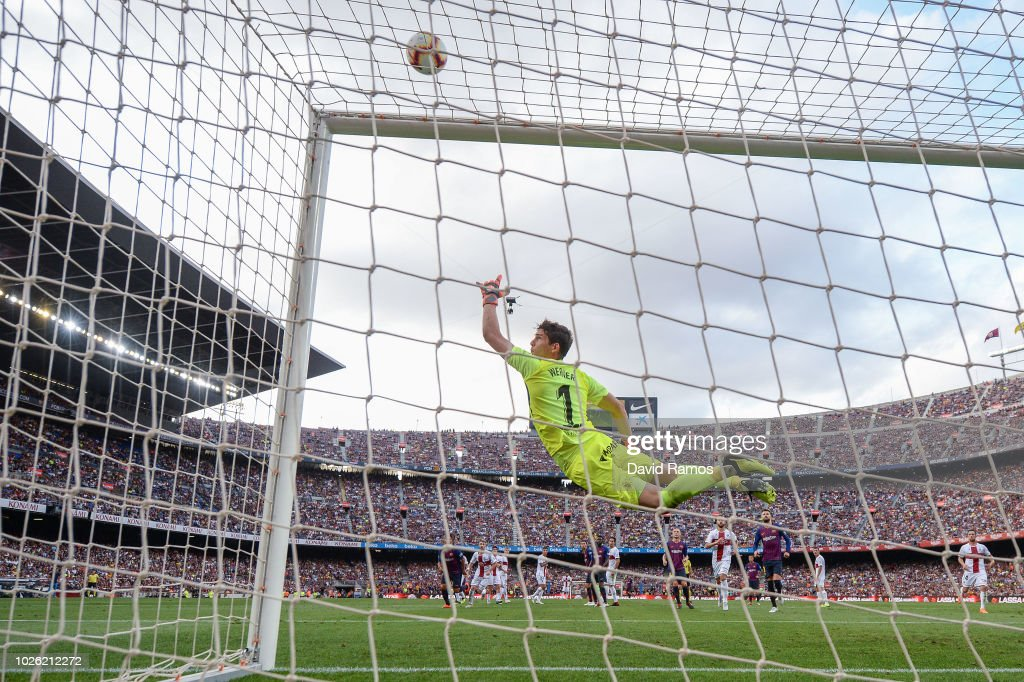 Lionel Messi of FC Barcelona misses a free kick during the La Liga match between FC Barcelona and SD Huesca at Camp Nou on September 2, 2018 in Barcelona, Spain.