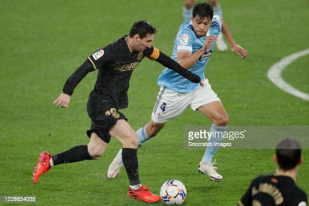Lionel Messi of FC Barcelona Nestor Araujo of Celta de Vigo during the La Liga Santander match between Celta de Vigo v FC Barcelona at the Estadio de...