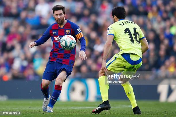 Lionel Messi of FC Barcelona pass the ball during the Liga match between FC Barcelona and Getafe CF at Camp Nou on February 15, 2020 in Barcelona,...