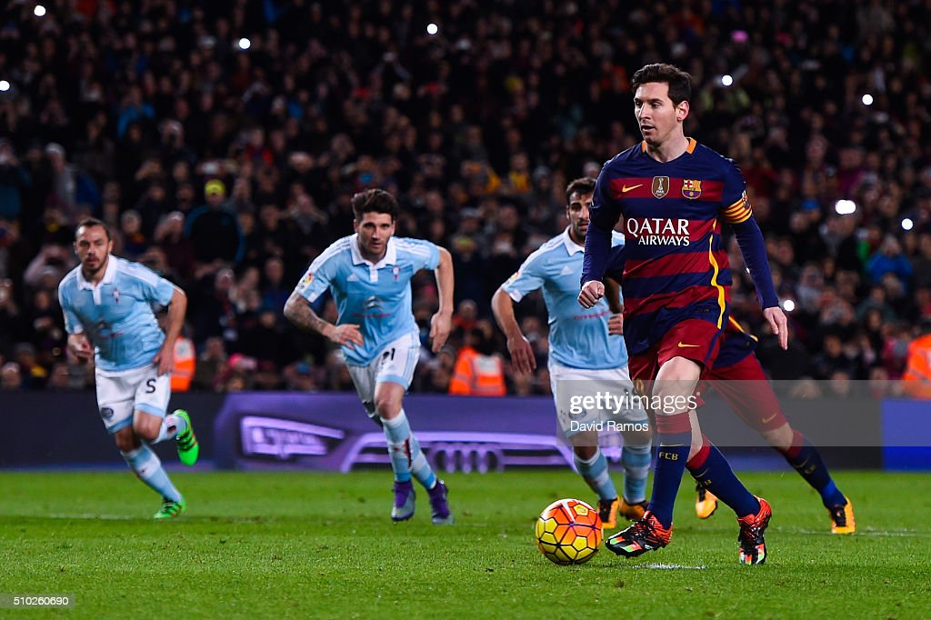 Lionel Messi of FC Barcelona passes to his teammate Luis Suarez of FC Barcelona from the penalty spot to scores his team's fourth goal during the La Liga match between FC Barcelona and Celta Vigo at Camp Nou on February 14, 2016 in Barcelona, Spain.