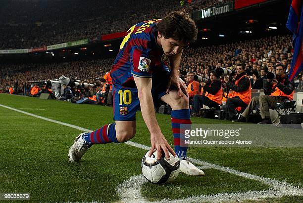 Lionel Messi of FC Barcelona place the ball in the corner during the La Liga match between Barcelona and Osasuna at the Camp Nou Stadium on March 24,...