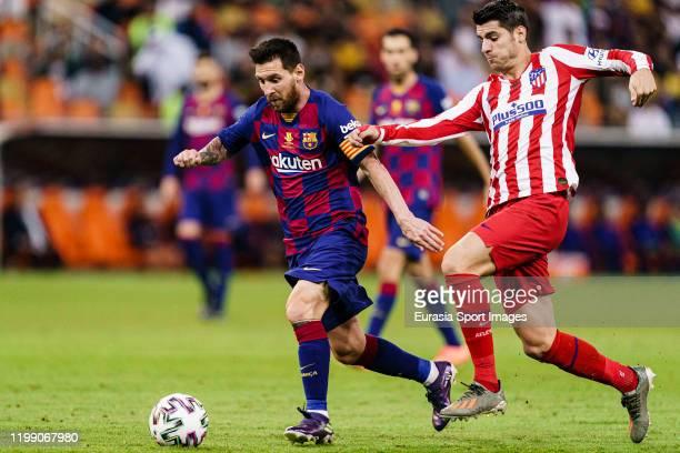 Lionel Messi of FC Barcelona plays against Alvaro Morata of Atletico de Madrid during the Supercopa de Espana SemiFinal match between FC Barcelona...