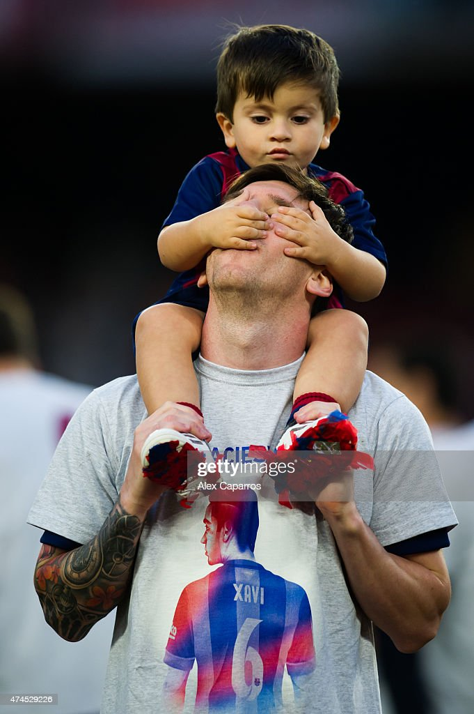 Lionel Messi of FC Barcelona plays with his son Thiago Messi after the La Liga match between FC Barcelona and RC Deportivo La Coruna at Camp Nou on May 23, 2015 in Barcelona, Spain.