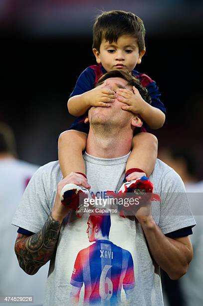 Lionel Messi of FC Barcelona plays with his son Thiago Messi after the La Liga match between FC Barcelona and RC Deportivo La Coruna at Camp Nou on...