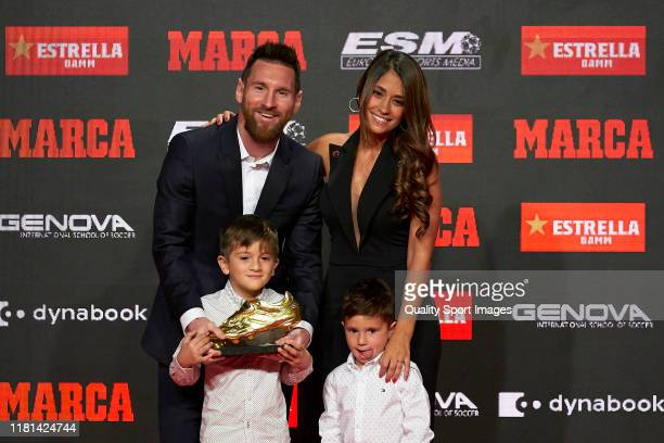 Lionel Messi of FC Barcelona poses with his family the sixth European Golden Boot awards after receiving the 201819 Season European Golden Shoe award...