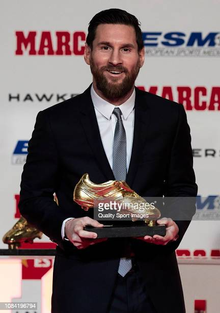Lionel Messi of FC Barcelona poses with his fifth European Golden Shoe award after receiving the 201718 Season European Golden Shoe award for...