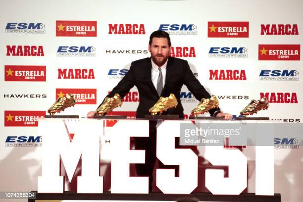 Lionel Messi of FC Barcelona poses with his five European Golden Boot awards after receiving the 201718 Season European Golden Shoe award for...