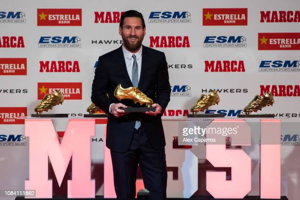 Lionel Messi of FC Barcelona poses with his five European Golden Shoe awards after receiving the 201718 Season European Golden Shoe award for...
