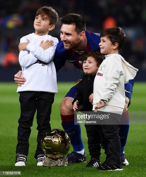 Lionel Messi of FC Barcelona poses with his sixth Ballon d'Or trophy and his children Ciro Messi Roccuzzo Thiago Messi Roccuzzo and Mateo Messi...