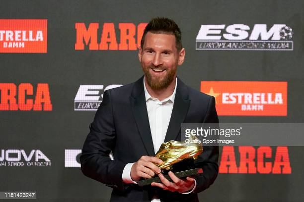 Lionel Messi of FC Barcelona poses with his sixth European Golden Boot awards after receiving the 201819 Season European Golden Shoe award for...