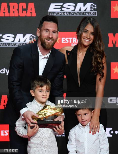 Lionel Messi of FC Barcelona poses with his wife Antonella Roccuzzo and their two sons after receiving the 201819 Season European Golden Shoe award...