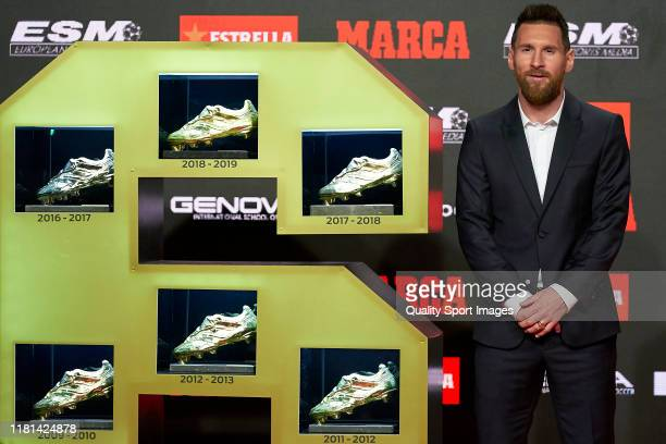 Lionel Messi of FC Barcelona poses with the sixth European Golden Boot awards after receiving the 201819 Season European Golden Shoe award for...