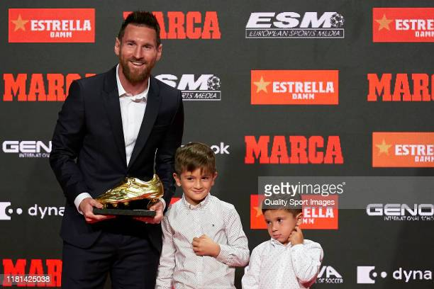 Lionel Messi of FC Barcelona poses with their two sons and the sixth European Golden Boot awards after receiving the 201819 Season European Golden...