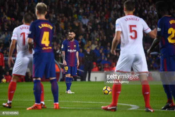 Lionel Messi of FC Barcelona prepares to take a freekick during the Spanish league football match between FC Barcelona and Sevilla FC at the Camp Nou...