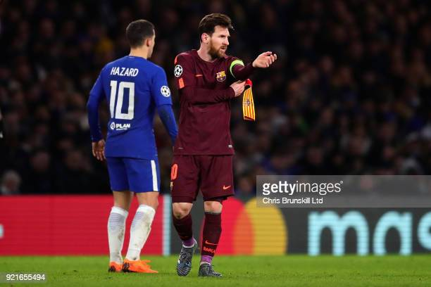 Lionel Messi of FC Barcelona puts on the captains armband during the UEFA Champions League Round of 16 First Leg match between Chelsea FC and FC...