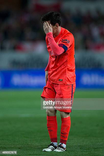 Lionel Messi of FC Barcelona reacts after being tackled during the La Liga match between Sevilla FC and FC Barcelona at Estadio Ramon Sanchez Pizjuan...