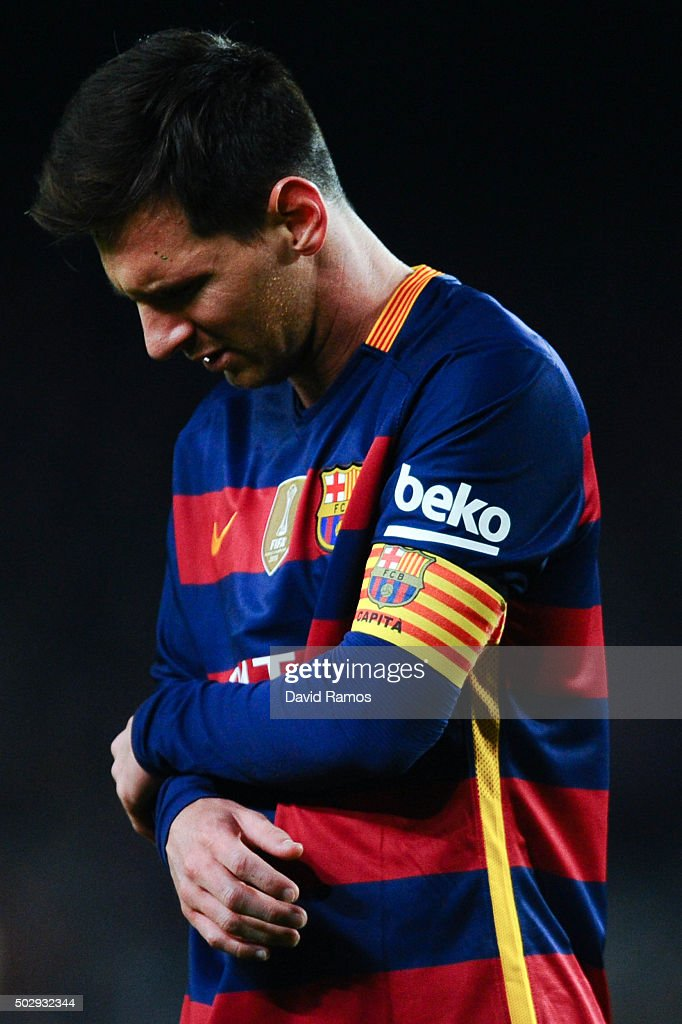 Lionel Messi of FC Barcelona reacts after clashing with Adan the La Liga match between FC Barcelona and Real Betis Balompie at Camp Nou on December 30, 2015 in Barcelona, Spain.
