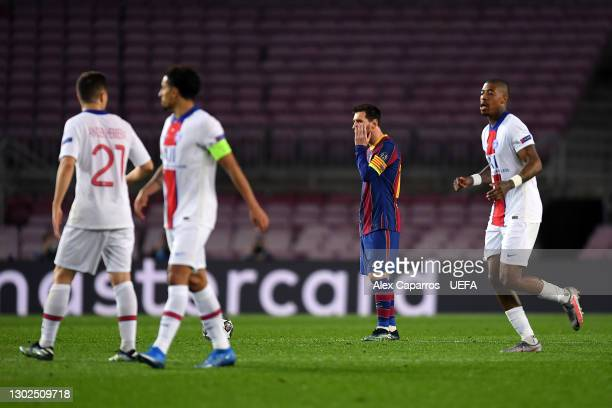Lionel Messi of FC Barcelona reacts after conceding during the UEFA Champions League Round of 16 match between FC Barcelona and Paris Saint-Germain...