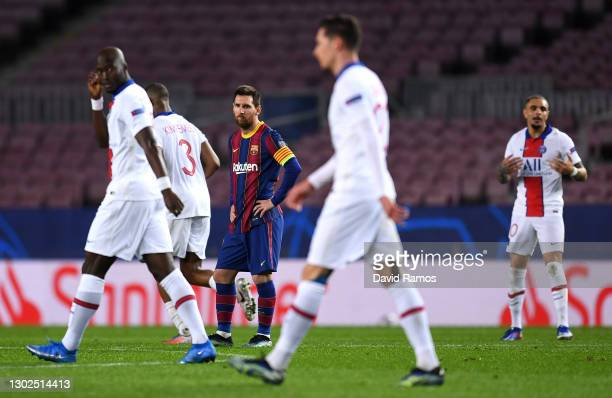 Lionel Messi of FC Barcelona reacts after conceding their fourth goal during the UEFA Champions League Round of 16 match between FC Barcelona and...