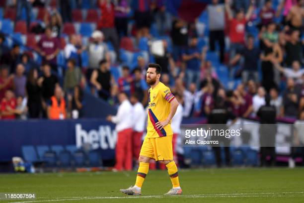 Lionel Messi of FC Barcelona reacts after Levante UD's third goal during the Liga match between Levante UD and FC Barcelona at Ciutat de Valencia on...