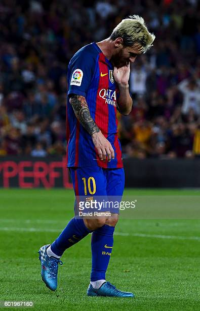 Lionel Messi of FC Barcelona reacts after missing a chance during the La Liga match between FC Barcelona and Deportivo Alaves at Camp Nou stadium on...