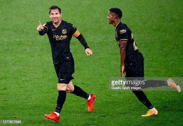 Lionel Messi of FC Barcelona reacts after scoring his team's third goal that was later disallowed during the La Liga Santander match between RC Celta...