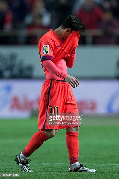 Lionel Messi of FC Barcelona reacts after the La Liga match between Sevilla FC and FC Barcelona at Estadio Ramon Sanchez Pizjuan on April 11 2015 in...