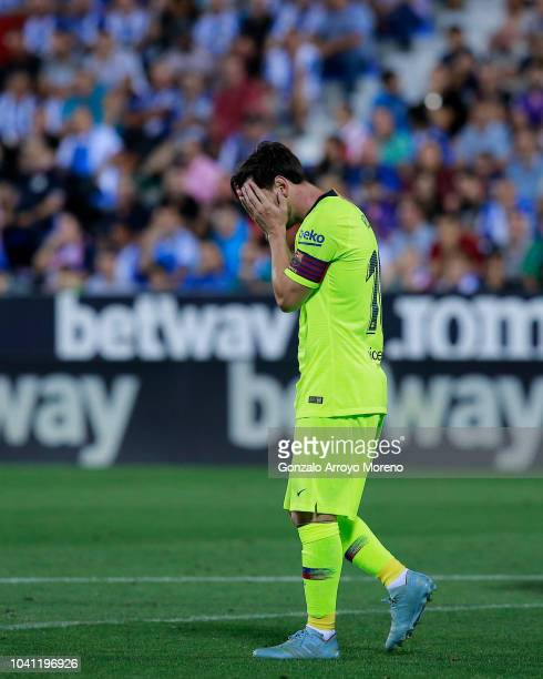 Lionel Messi of FC Barcelona reacts as he fails to score during the La Liga match between CD Leganes and FC Barcelona at Estadio Municipal de...