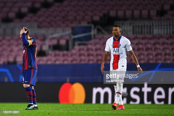 Lionel Messi of FC Barcelona reacts as Kylian Mbappe of Paris Saint-Germain looks on after celebrating his side's fourth goal during the UEFA...